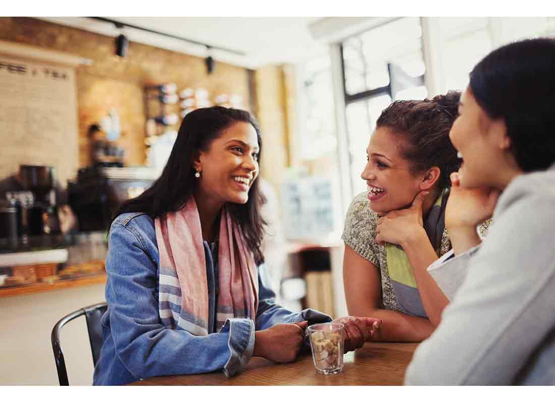 friends talking at coffee shop