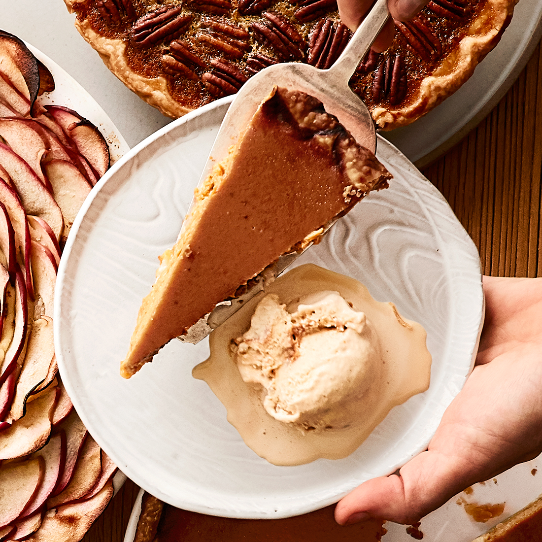 dishing pumpkin pie onto plate