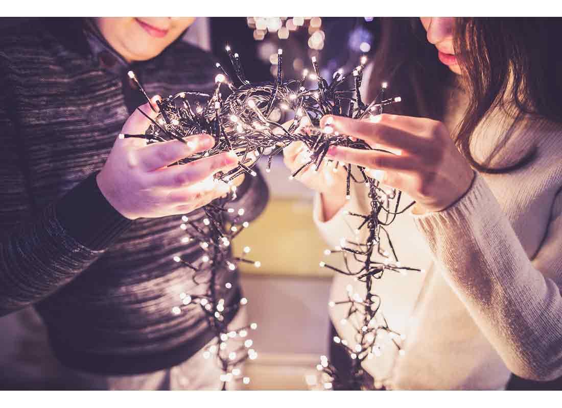 teens trimming the christmas tree