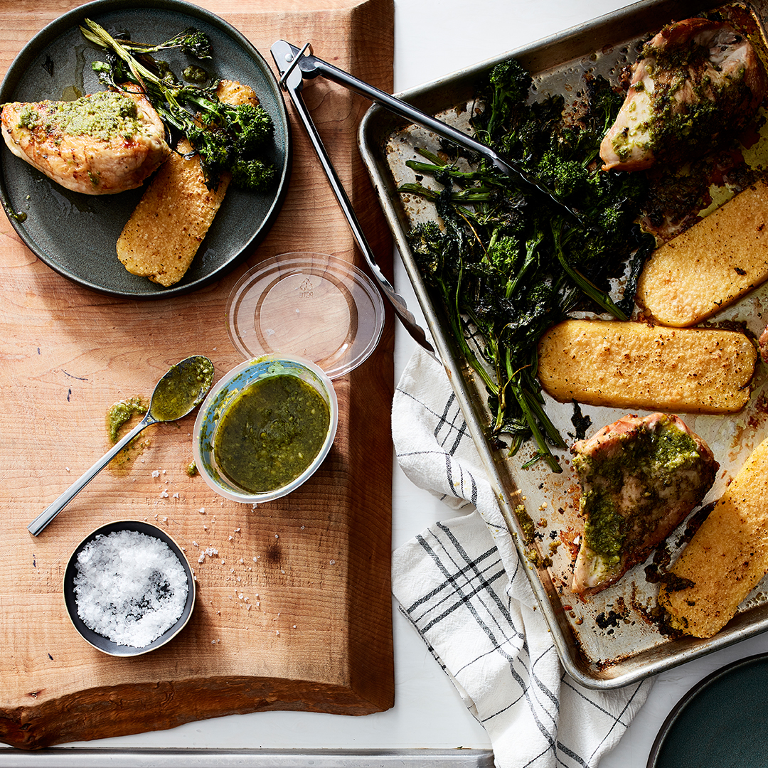 Sheet Pan Pesto Chicken with Polenta on plate and pan