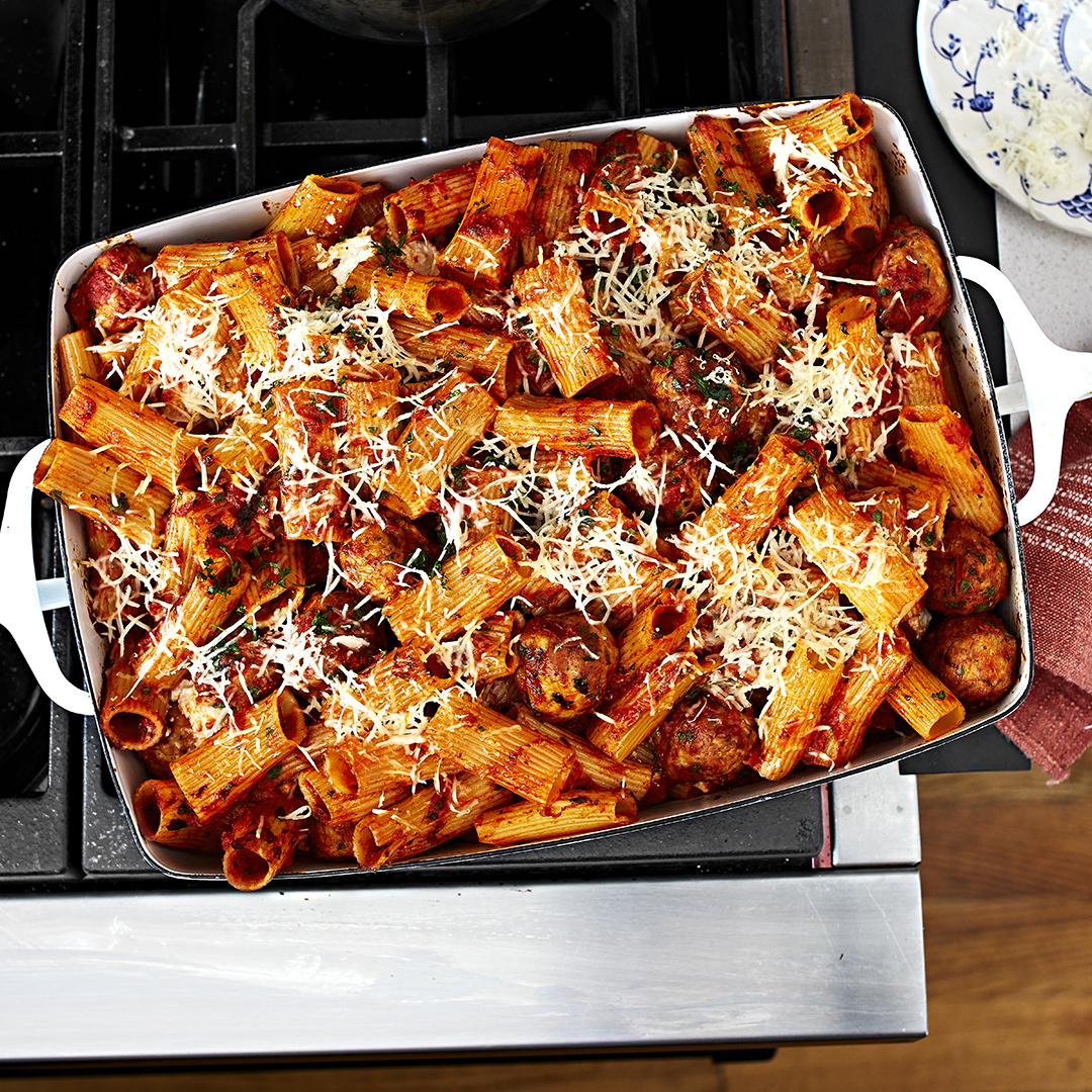 Baked Rigatoni and Meatballs in white pan on stove