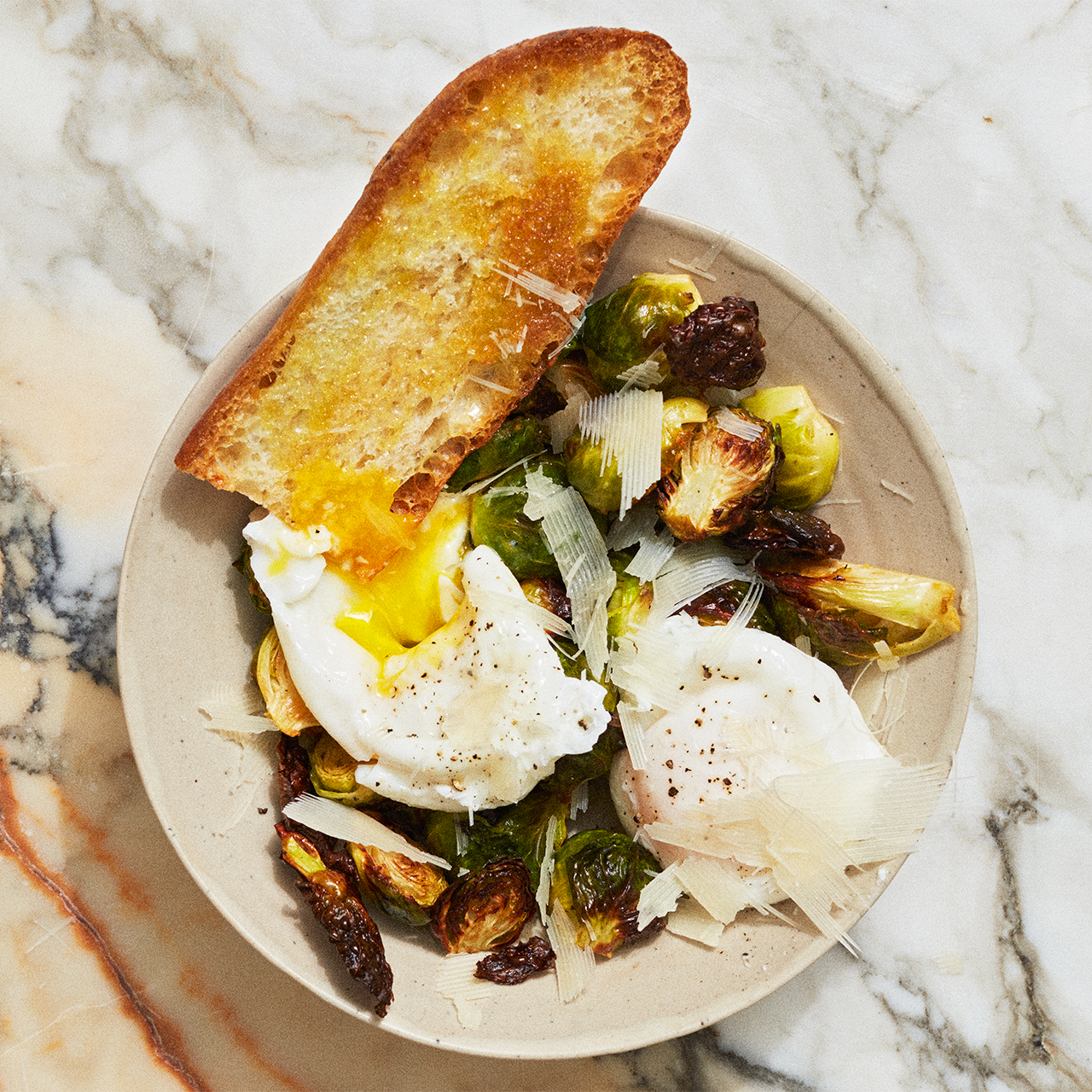 poached egg with brussels sprouts and parmesan