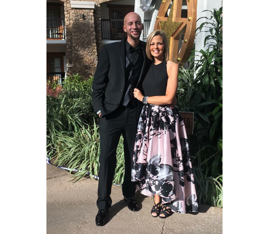 Tiffany Howard AFTER weight loss, wearing blank & pink skirt, with husband