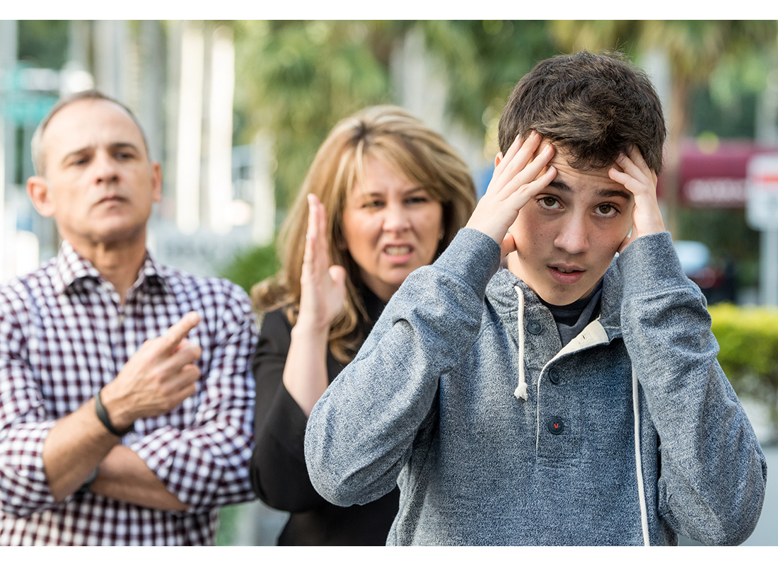teen boy in trouble with parents