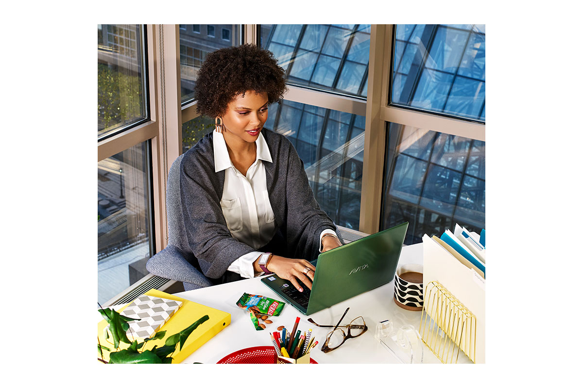 successful career woman working on laptop