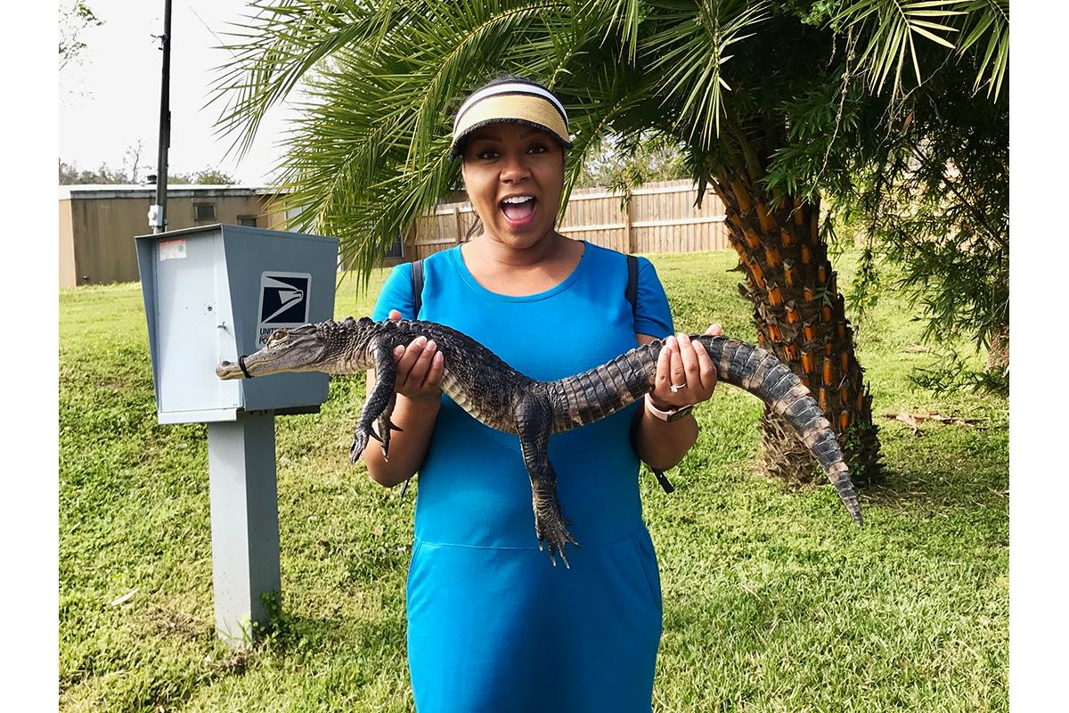 woman holding a baby alligator at Black Hammock Adventures Airboat Ride in Florida