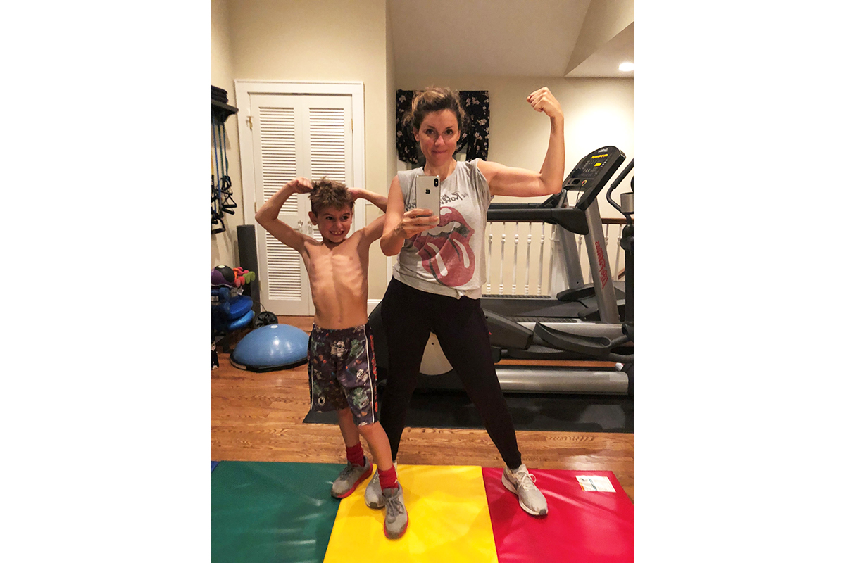 Amy Ruggiero, after her weight loss, works out with her son