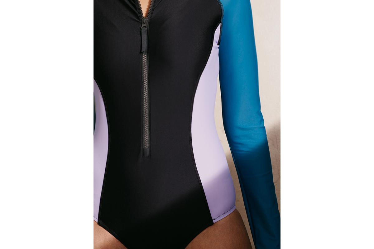 woman in long-sleeve swimsuit