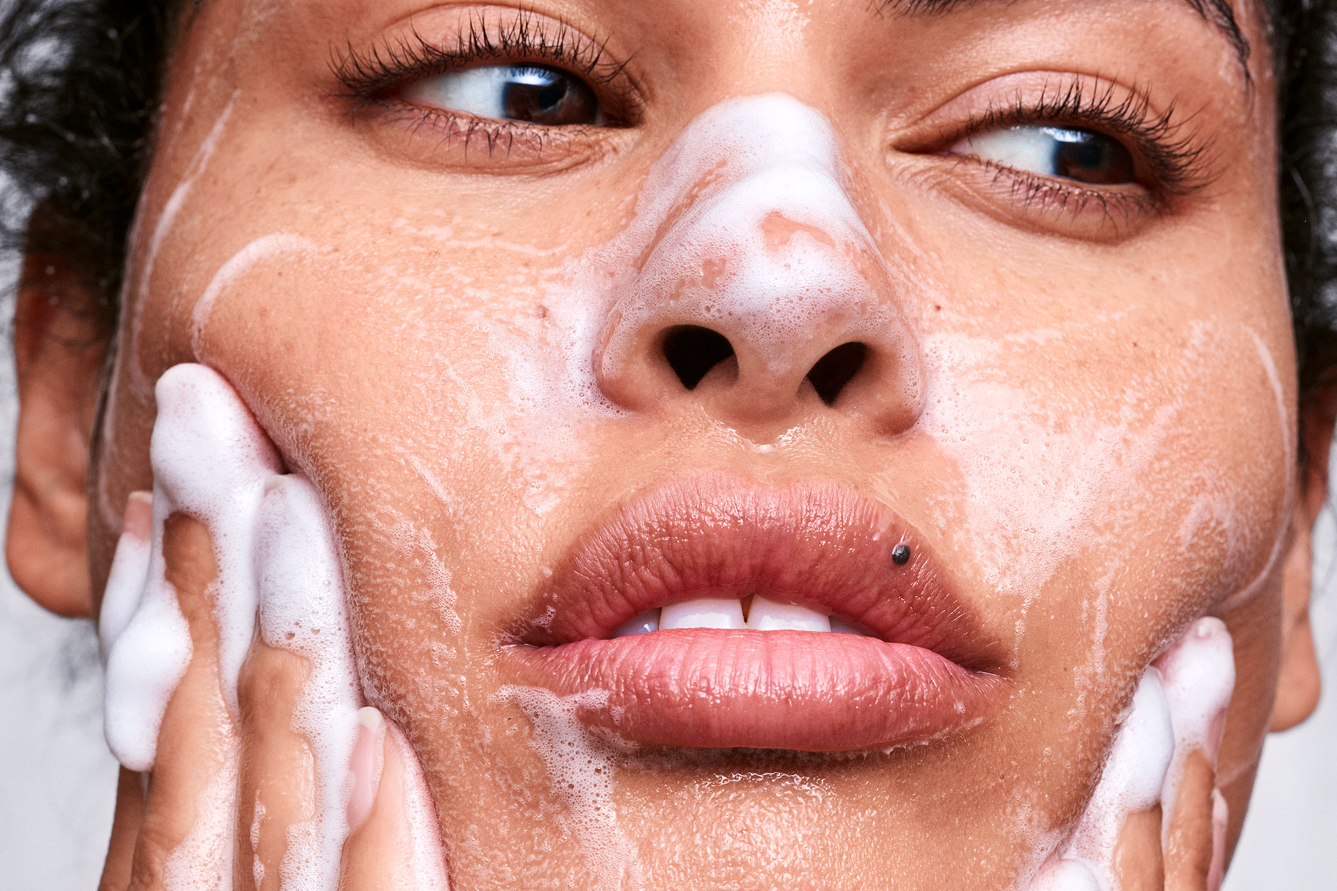 face washing with soapy cleanser