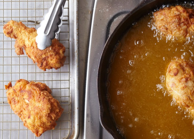 Fried Chicken From Oil to Rack with Tongs