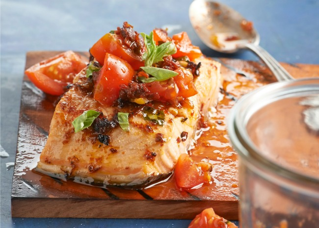 Planked salmon with cherry tomato and basil relish
