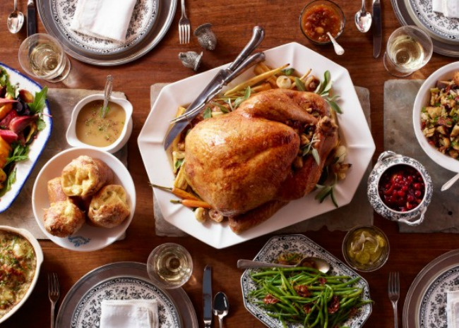 Thanksgiving dinner on table with wine glasses