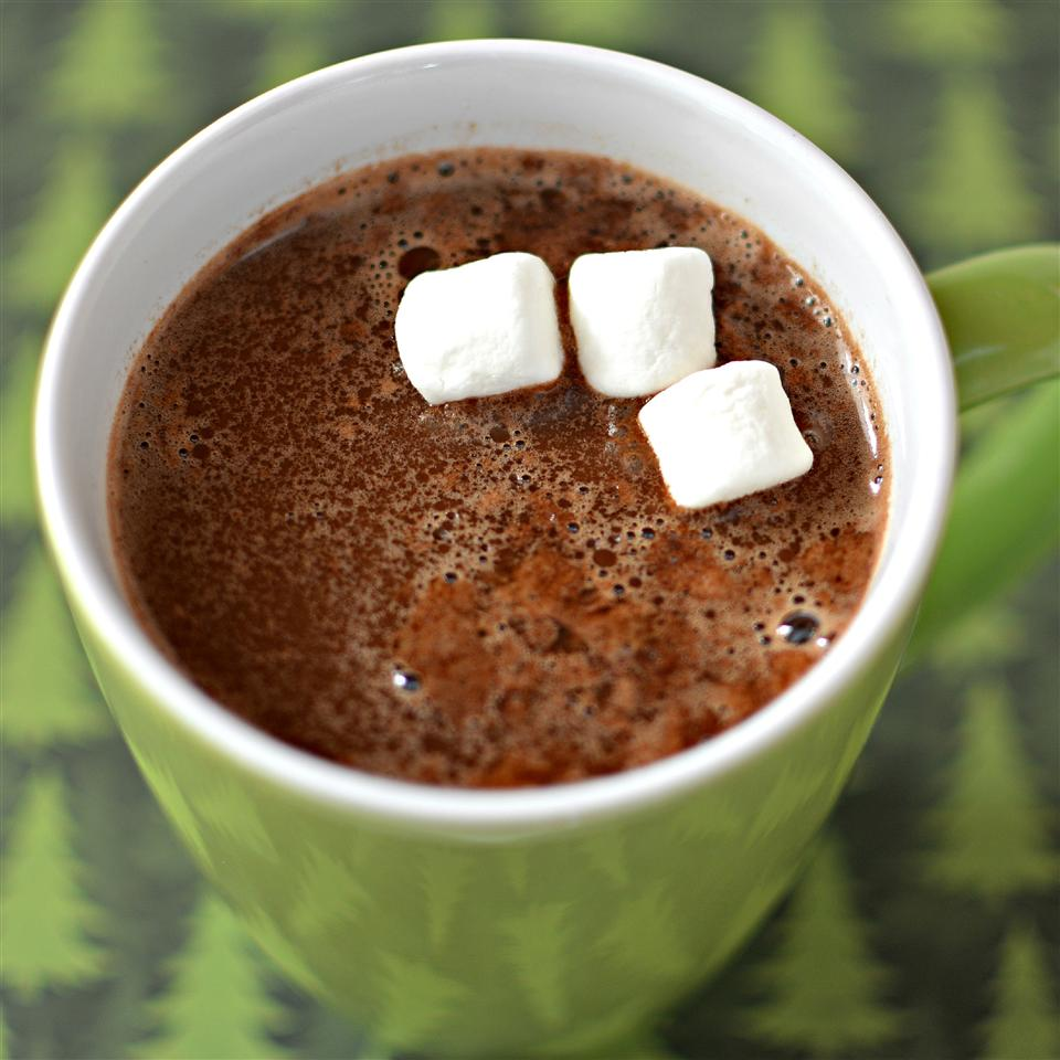 hot chocolate with marshmallows in a green cup