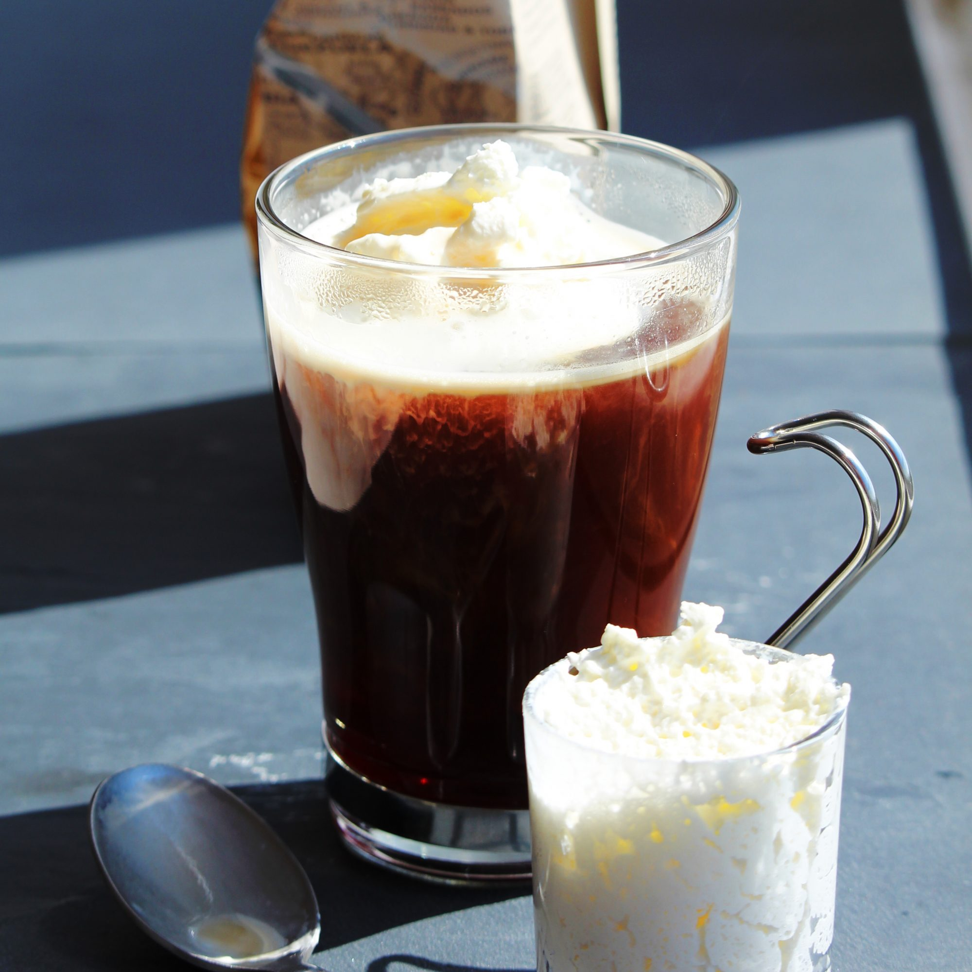hot chocolate in a glass with whipped cream