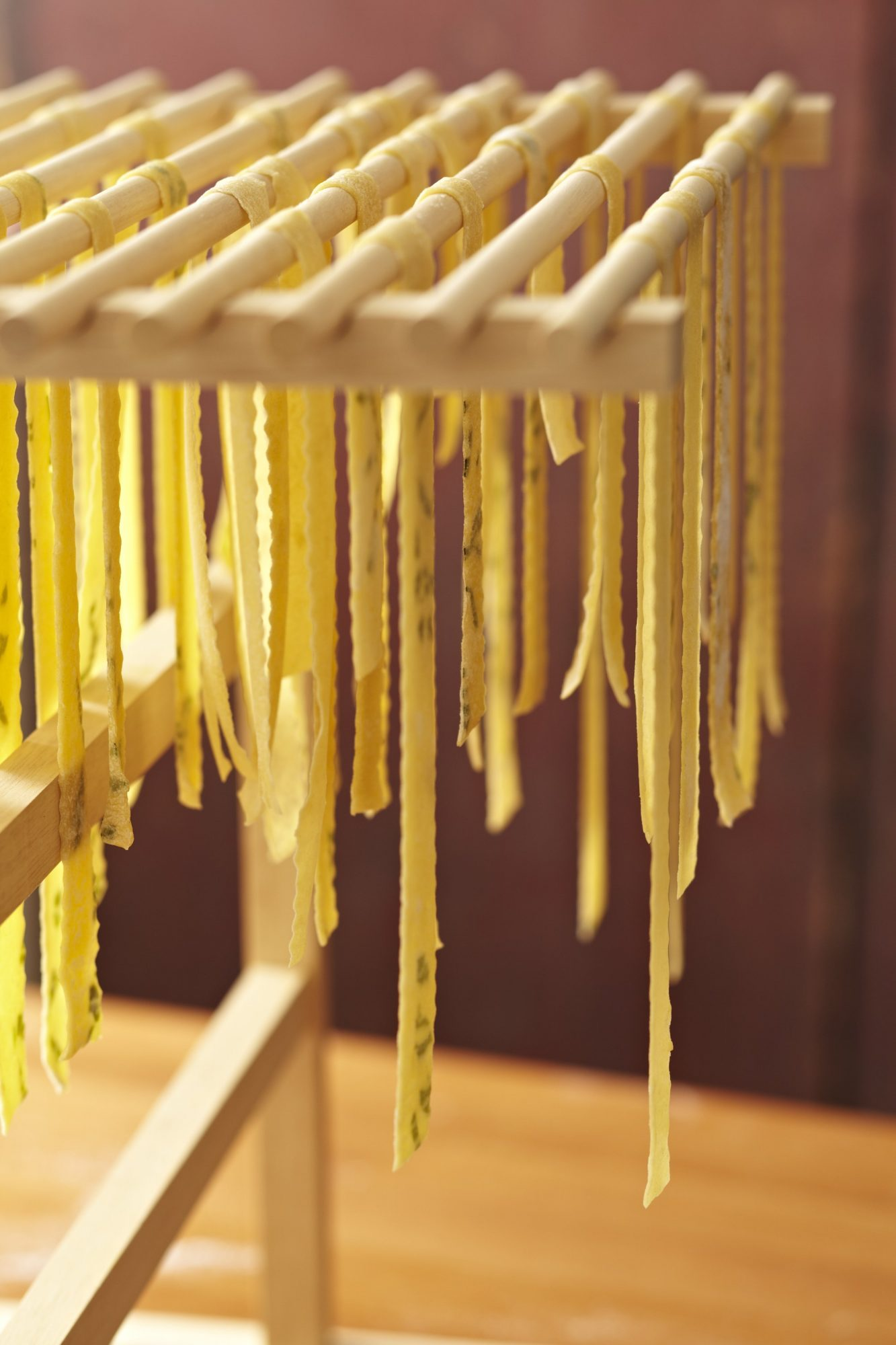 101910770_Cut-Fettuccine-Hanging-from-Pasta-Rack_Photo-by-Meredith.jpg