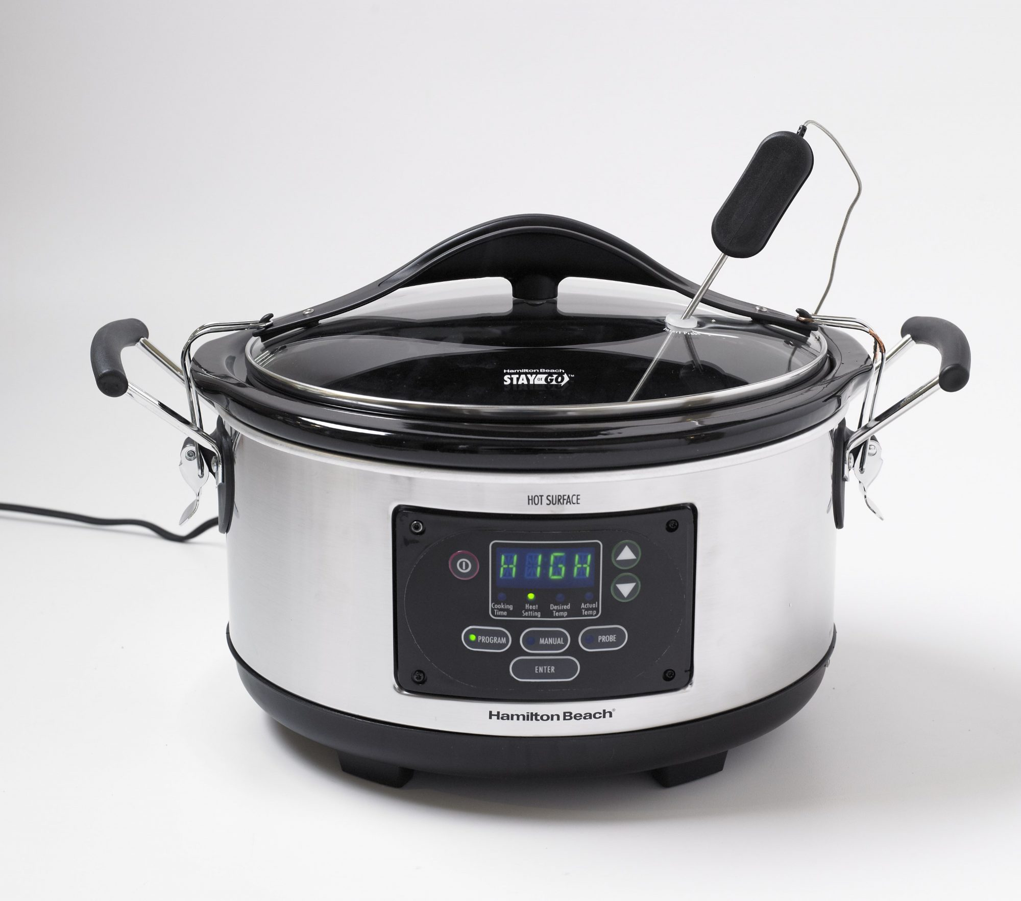 Slow Cooker with clipon lid and stirrer attachment