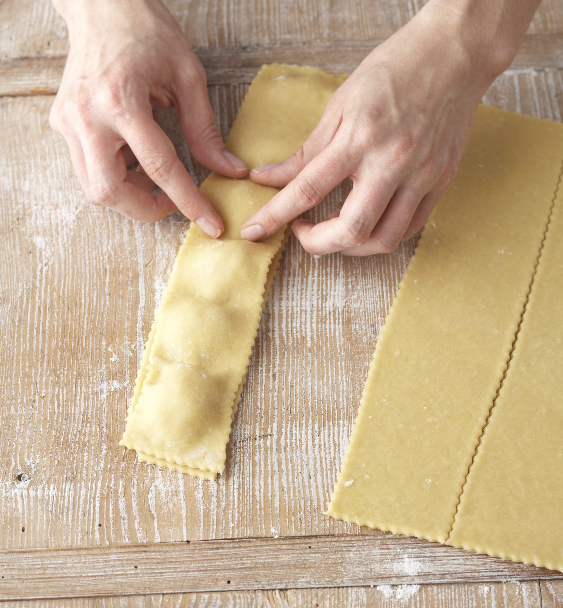 pinching the top and bottom layers of ravioli