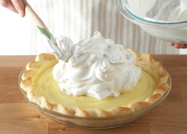 Spooning Whipped Cream onto Pie