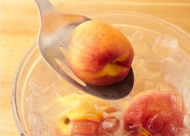 Shock Blanched Peaches in Ice Water