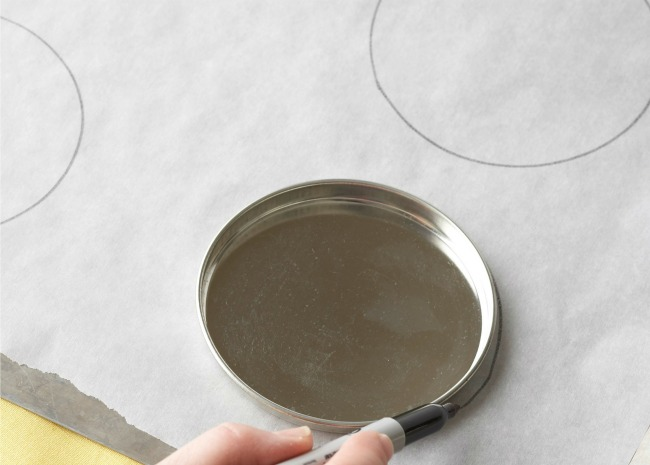 Drawing circle on parchment for parmesan rounds
