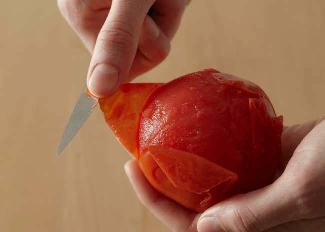 Peeling a tomato resized. Photo by Meredith