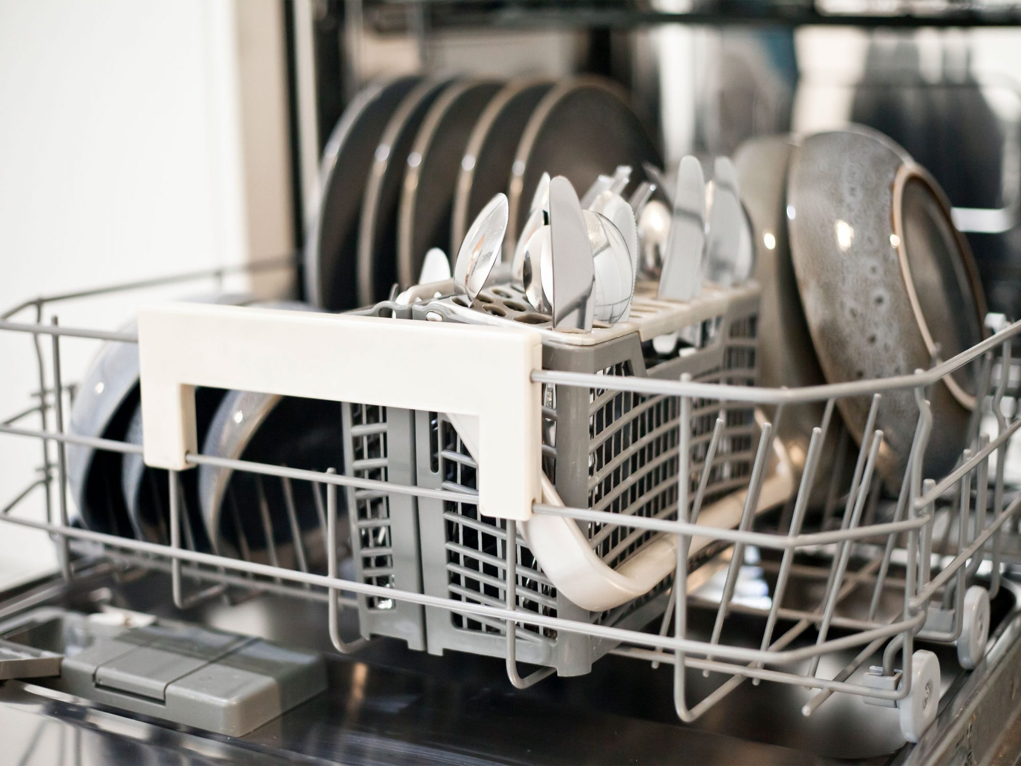Dishwasher bottom rack loaded with clean dishes