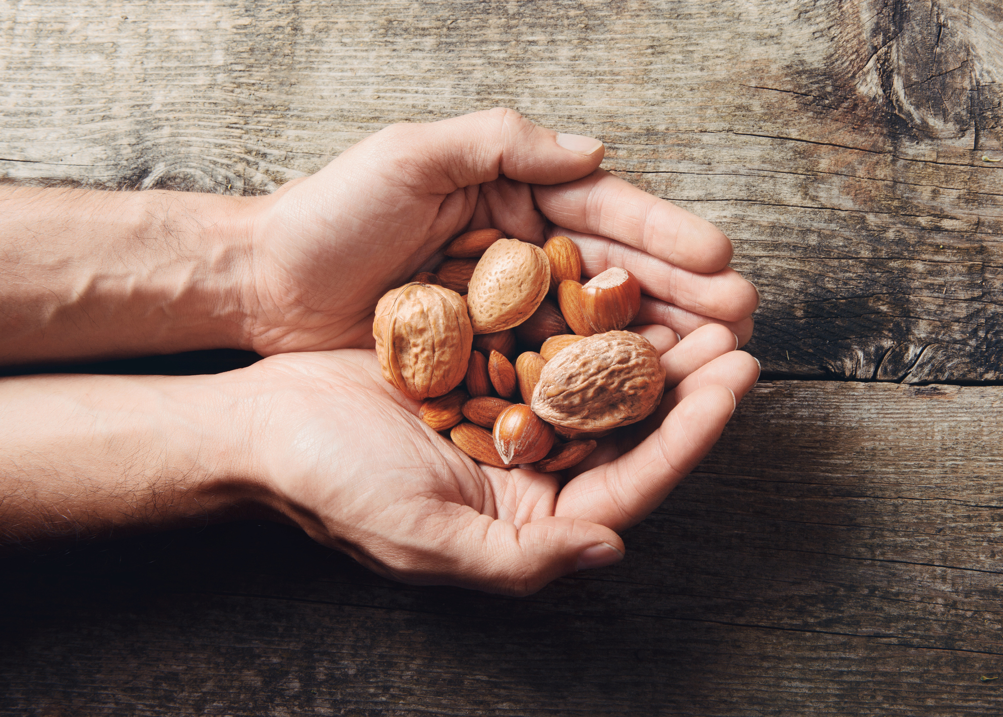 Almonds and Walnuts in Hand