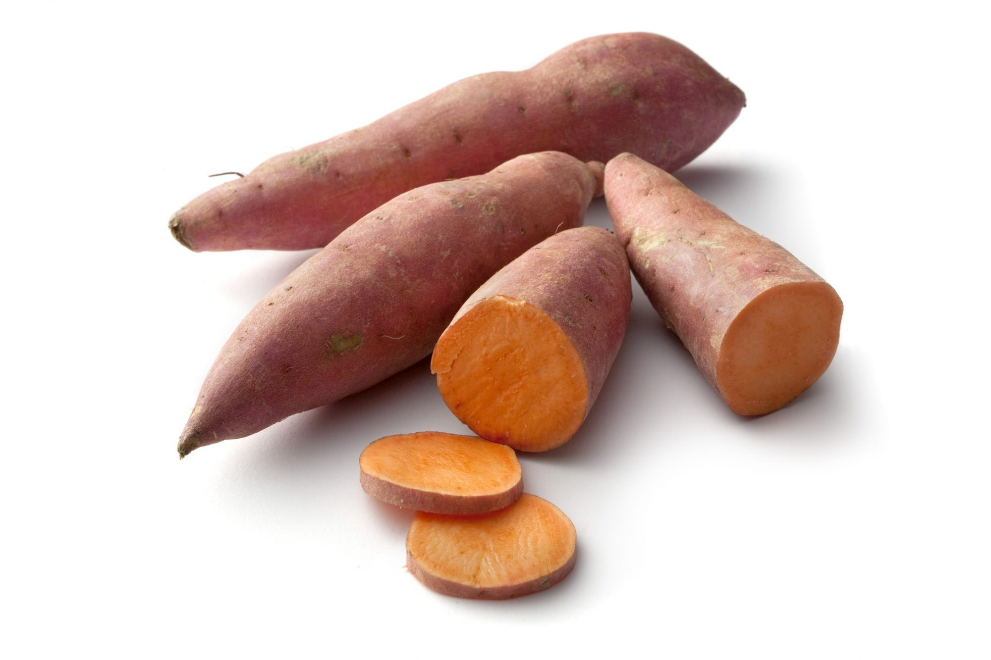 raw sweet potatoes whole and sliced