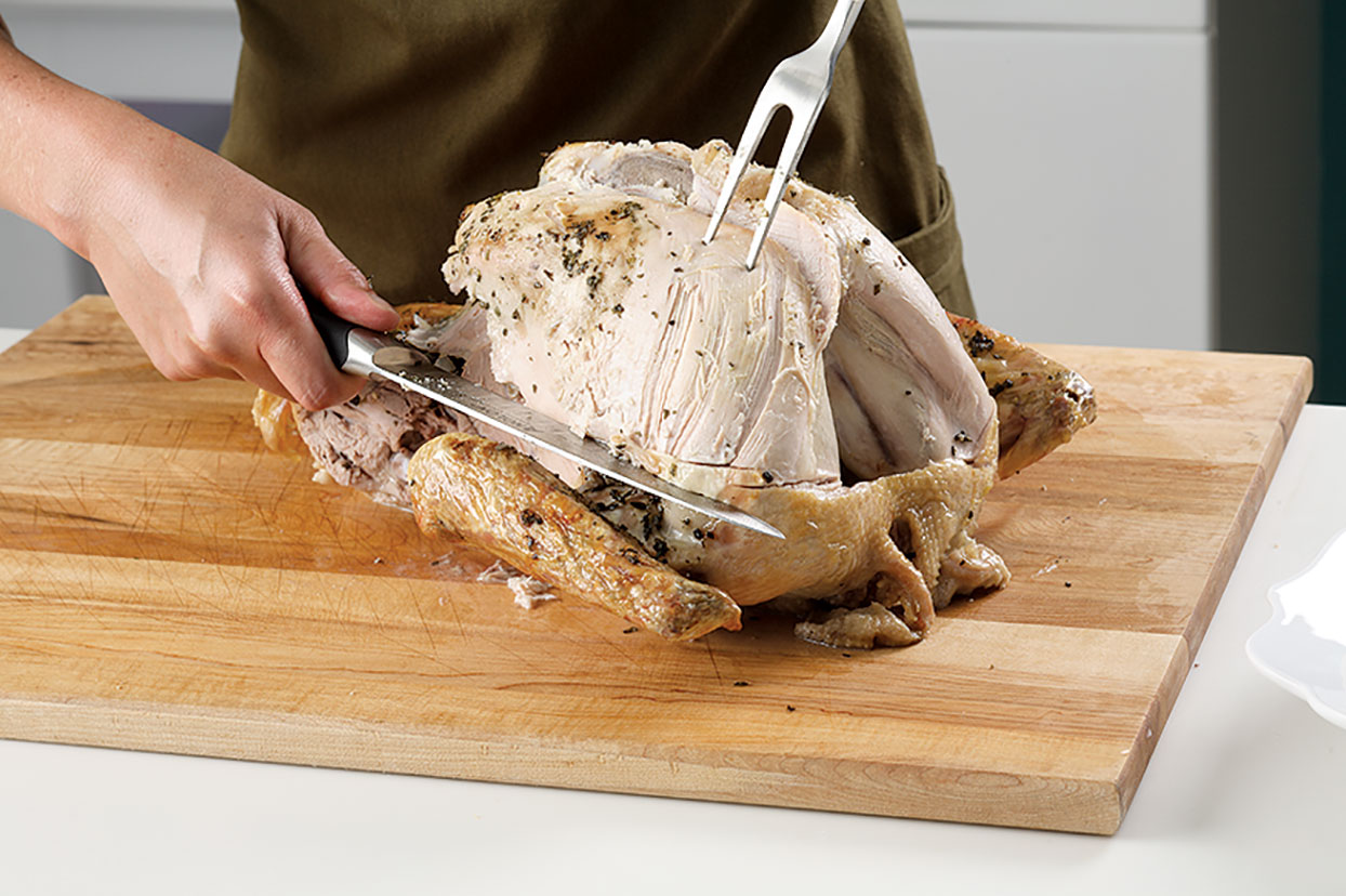 Carving a turkey: removing lobes of breast meat