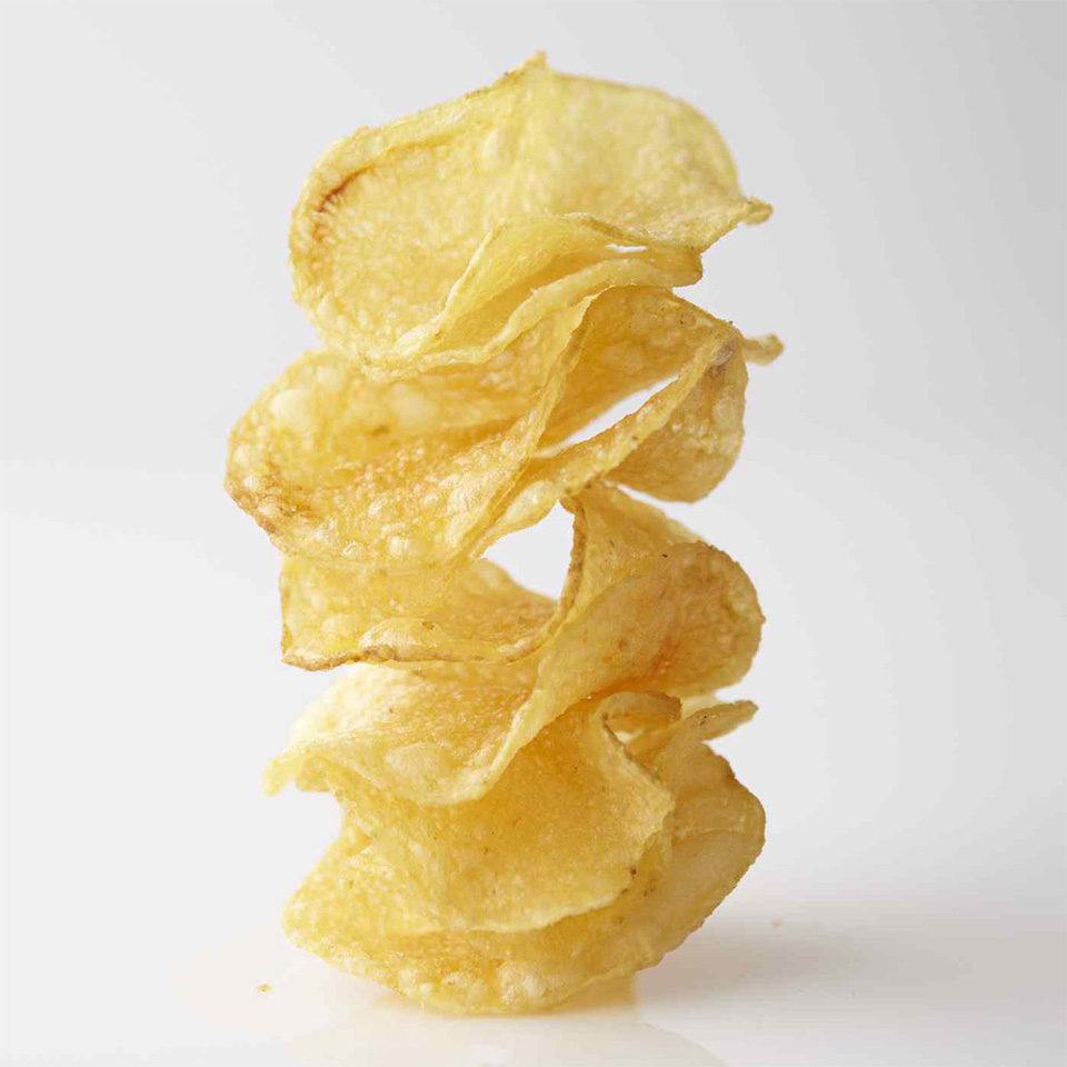 a few kettle potato chips stacked on top of each other
