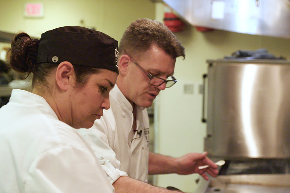 man and woman cooking together in kitchens for good