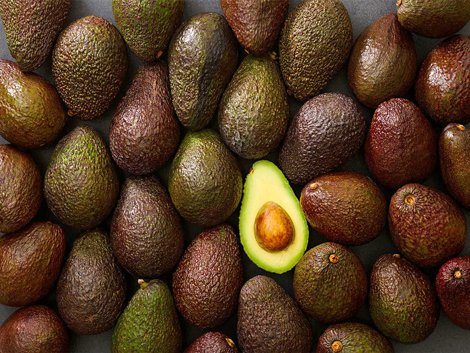 hass avocados arranged on table