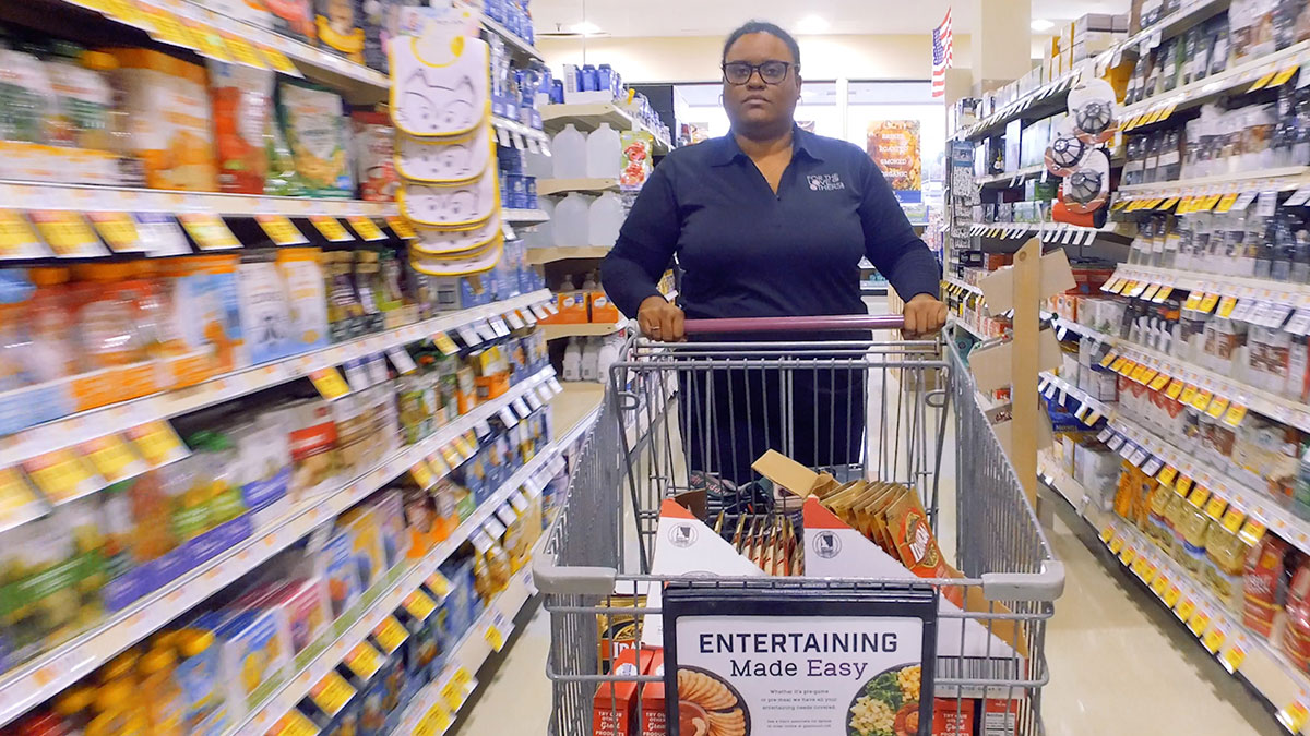 Woman pushing a grocery cart in a store