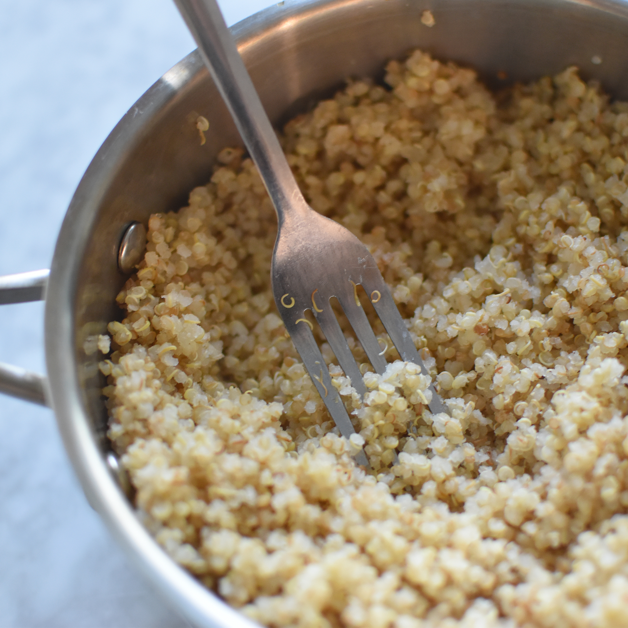 uncover and fluff quinoa with fork