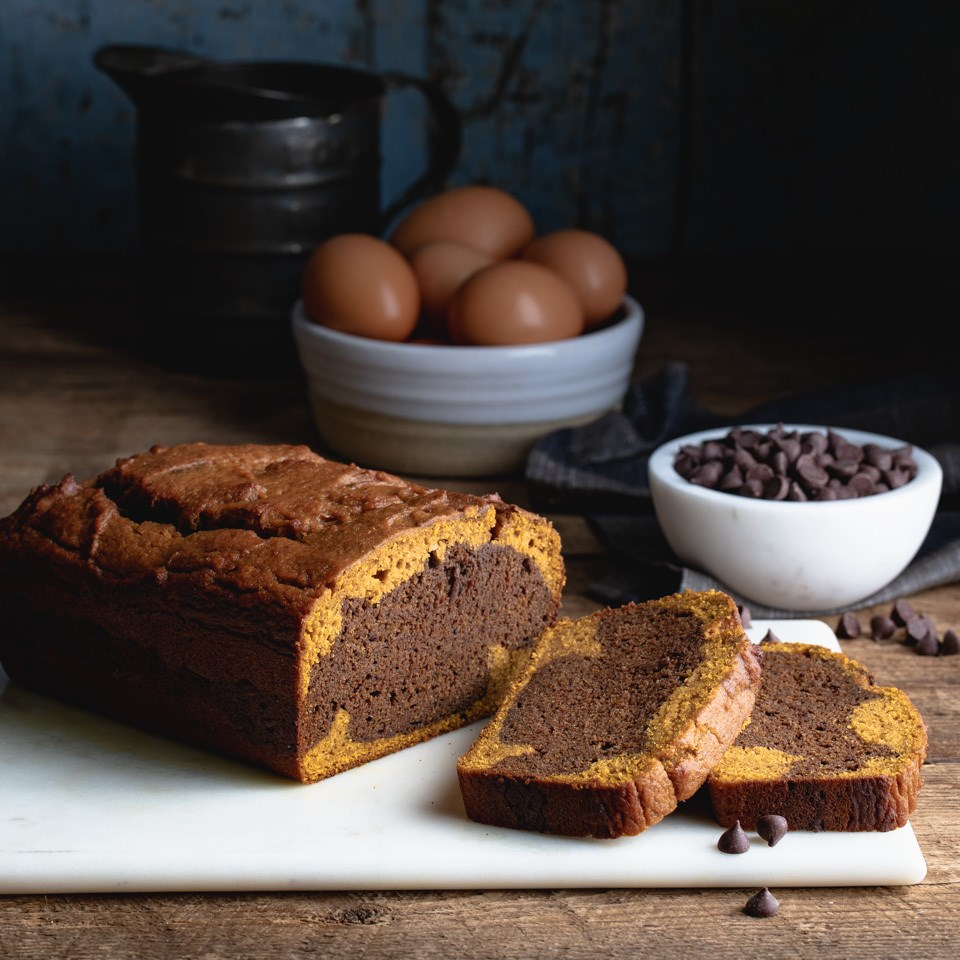 Chocolate Pumpkin Swirl Bread on a cutting board with 2 slices laid out