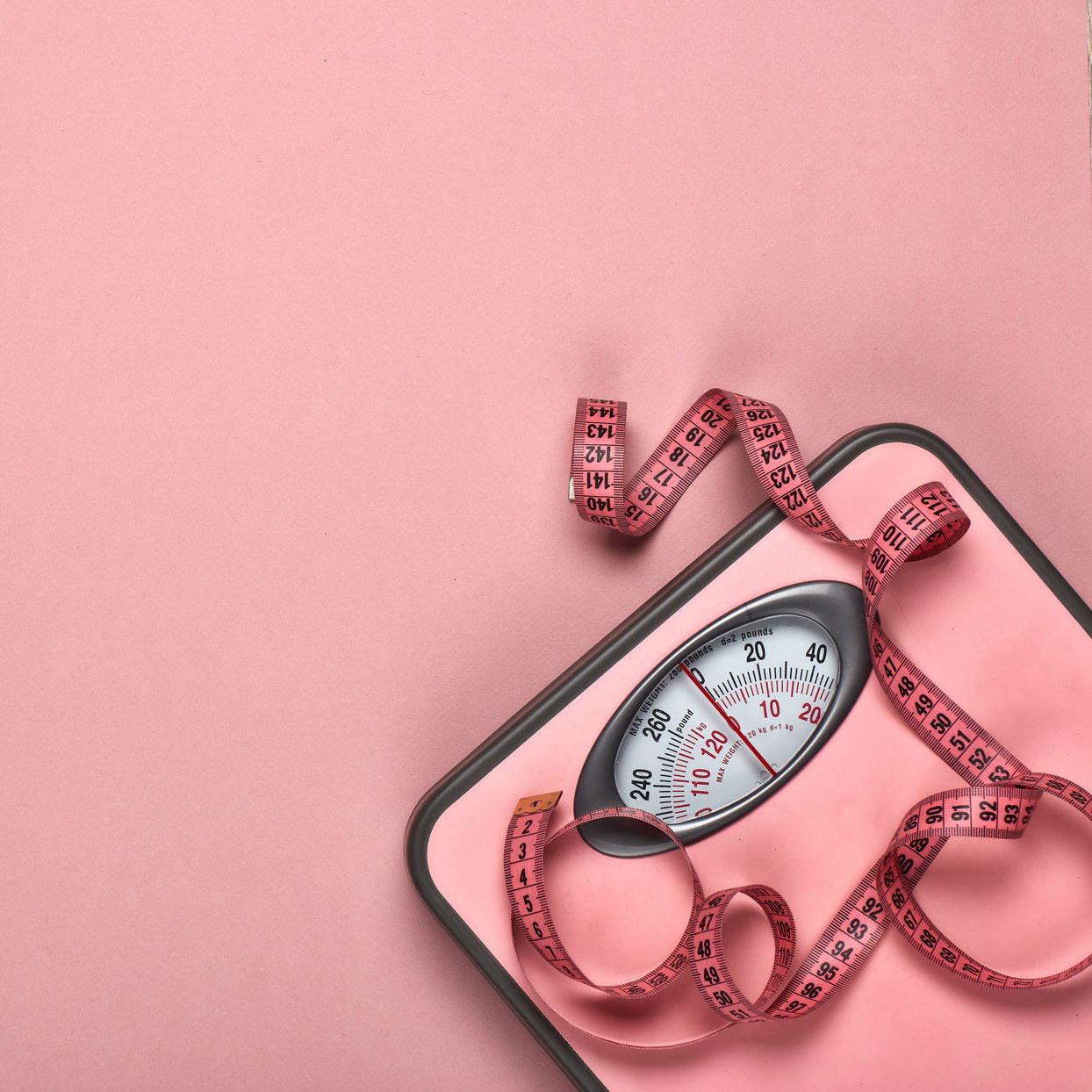 pink scale with pink measuring tape draped on top