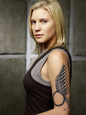 Battlestar Galactica, Katee Sackhoff | KARA ''STARBUCK'' THRACE (KATEE SACKHOFF) Most Badass Moment: Held captive in a bizarro domestic setting by the Cylon Leoben, Starbuck stays quiet as her abductor…