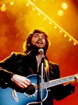 Eddie Rabbitt | Step by step, this fuzzy-faced soft rocker hopped up the charts in the early '80s. Oh, he loved a rainy night, oh, yes he do.…