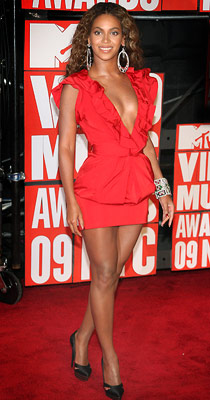 Beyonce Knowles | We loved Beyonce's bold color choice and the plunging ruffle neckline, but the extra flap of fabric and shortie hem made for a not-so-bootylicious bottom.