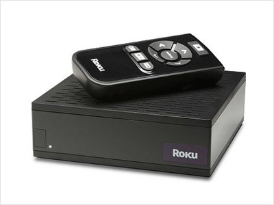 Who wants to watch everything on a computer screen? The ludicrously simple Roku hooks up to your TV like a DVD player, but instead of…