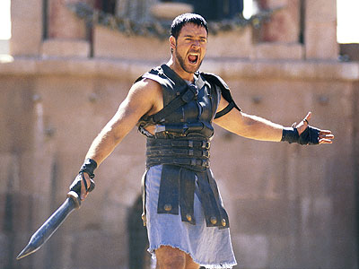 Gladiator, Russell Crowe | MAXIMUS DECIMUS MERIDIUS (RUSSELL CROWE) Most Badass Moment: Maximus fights lions, chariots, and emperors, but the part we remember is the single most awesome action-movie…