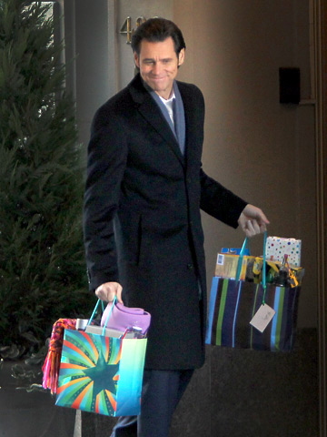 Jim Carrey comes bearing gifts in this scene on the set of his new movie Mr. Popper's Penguins on Park Avenue in New York.