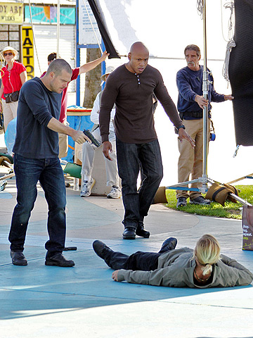 Chris O'Donnell and LL Cool J in the heat of the moment on the set of NCIS: Los Angeles at the Venice boardwalk in L.A.