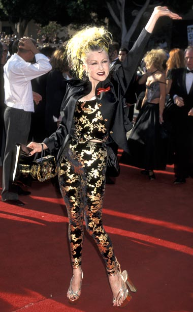 Cyndi Lauper | Singer-turned-actress Cyndi Lauper matched her wild hair to her exotic black and gold brocade jumpsuit—and slipped on a pair of what look to be stripper…