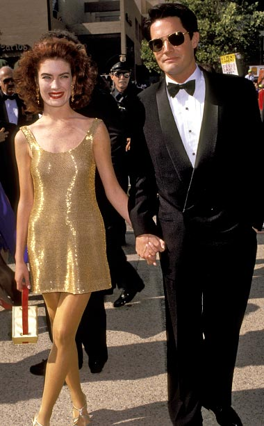 Lara Flynn Boyle | The dress, the tights, the hair, the lips—there's nothing redeeming about Lara Flynn Boyle?s look. The actress attended the 43 annual Emmy Awards dressed as…