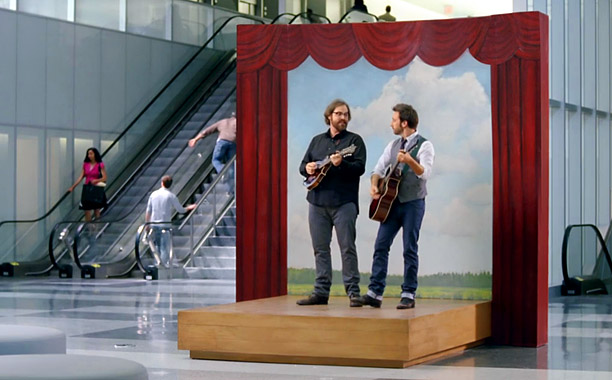 How happy are we when these insurance ads — featuring a pair of plucky dudes on guitar and mandolin — come on? Happier than Dikembe…