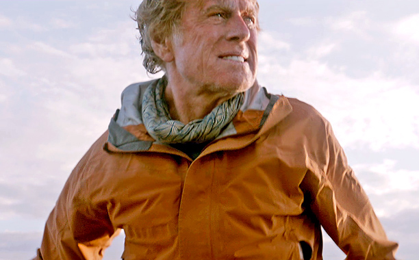 He barely says a word, but that's the power of the 77-year-old's performance. Redford stars alone as a man stranded on a damaged sailboat in…