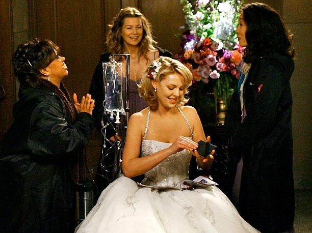 Grey's Anatomy | In the show's 100th episode, Izzie (Katherine Heigl) is busy preparing for the wedding of Meredith (Ellen Pompeo) and Derek (Patrick Dempsey) when her hallucinations…
