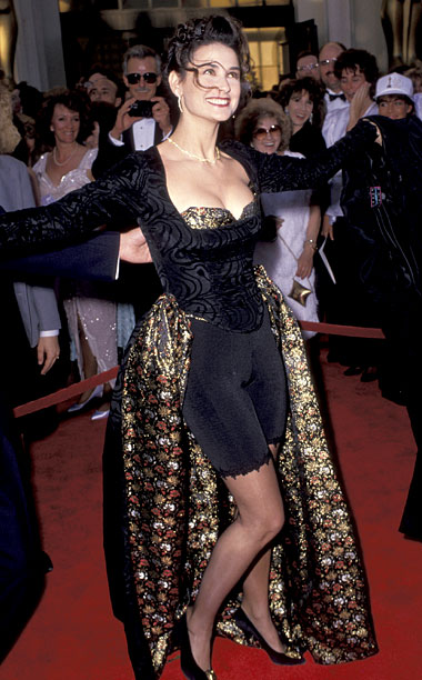 Style | Consider Moore's 1989 Oscars look — comprised of a black spandex bike shorts, bustier top and brocade evening gown combo — early fodder for Joan…