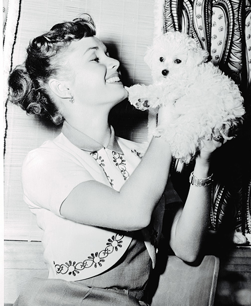 Debbie Reynolds With Her Dog in the Late 1950s